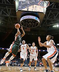 Miami Hurricanes guard Renee Taylor (3) shoots against Virginia Cavaliers Forward Lyndra Littles (1).  The University of Virginia Cavaliers defeated the Miami Hurricanes Women's Basketball Team 73-60 at the John Paul Jones Arena in Charlottesville, VA on February 4, 2007.