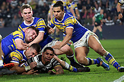 It takes five Leeds Rhinos players to bring down Hull FC half back Albert Kelly (6) during the Betfred Super League match between Hull FC and Leeds Rhinos at Kingston Communications Stadium, Hull, United Kingdom on 19 April 2018. Picture by Mick Atkins.