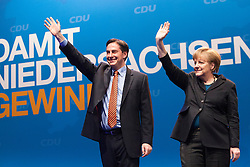 The half-Scottish governor of Lower Saxony, David McAllister and German Chancellor Angela Merkel at an election campaign event at Hildesheim, Germany..©Michael Schofield.