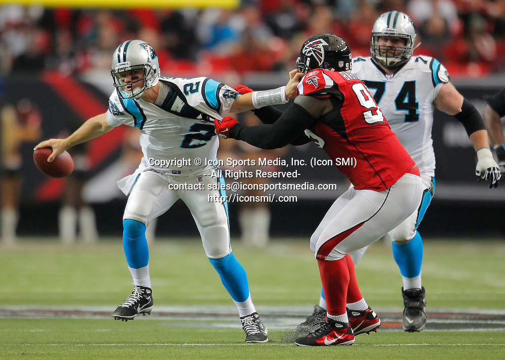 02 January 2011: Carolina Panthers quarterback Jimmy Clausen (2) is sacked by Atlanta Falcons defensive tackle Jonathan Babineaux (95) in the Atlanta Falcons 31-10 victory over the Carolina Panthers at the Georgia Dome in Atlanta Georgia.