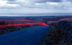 UK ENGLAND LAKE DISTRICT NOV99 - A passing car leaves a ray of lights on a road near Sellafield. . . jre/Photo by Jiri Rezac. © Jiri Rezac 1999. Tel:   +44 (0) 7050 110 417. Email: info@jirirezac.com. Web:   www.jirirezac.com