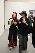 CHAY LEE; JAEHAE LEE, Frieze week Drinks Party at the opening of the exhibition Island at the Dairy arts Centre, 7a Wakefield Street, Bloomsbury, London. 18 October 2013.
