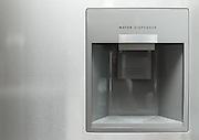 Water dispenser in modern steel fridge