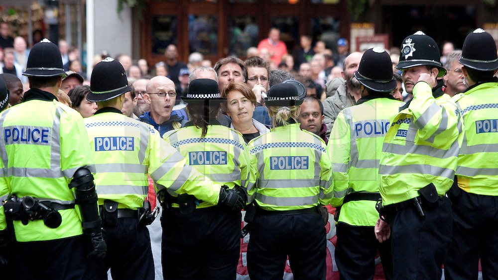 © Licensed to London News Pictures. 29/10/2011. Birmingham, UK. FILE PICTURE DATED 05/09/2009. Police hold back opposition at an English Defence League demonstration from September 2009. Photo credit : Joel Goodman/LNP