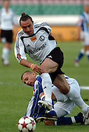 n/z.: Marek Saganowski (nr10-Legia) , Rafal Lasocki (nr3-Lech) podczas meczu ligowego Legia Warszawa (biale) - Lech Poznan (niebieskie-biale) 3:0 , I liga polska , 21 kolejka sezon 2004/2005 , pilka nozna , Polska , Warszawa , 07-05-2005 , fot.: Adam Nurkiewicz / mediasport..Marek Saganowski (nr10-Legia) , Rafal Lasocki (nr3-Lech) fight or the ball during Polish league first division soccer match in Warsaw. May 07, 2005 ; Legia Warsaw (white) - Lech Poznan (blue-white) 3:0 ; first division , 21 round season 2004/2005 , football , Poland , Warsaw ( Photo by Adam Nurkiewicz / mediasport )