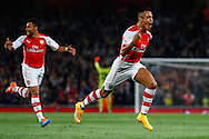 Alexis Sanchez of Arsenal (right) celebrates scoring the opening goal during the Capital One Cup match at the Emirates Stadium, London<br /> Picture by David Horn/Focus Images Ltd +44 7545 970036<br /> 23/09/2014