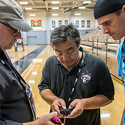 Behind the scenes at day 3 of Sports Shooter Academy X1 where participants photographed Irvine Valley College's women's volley ball team take on Saddleback College in Costa Mesa, California on 11/7/14 .  Michael Der / Sports Shooter Academy X1 Behind the Scenes with the cast and crew of Sports Shooter Academy.