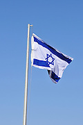 Israeli Flag on blue sky background