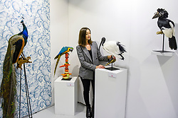 © Licensed to London News Pictures. 05/10/2019. LONDON, UK. Artist Elle Kaye, who specialises in taxidermy, with some of her works at The Other Art Fair, presented by Saatchi Art.  120 international, independent artists are displaying their works to be sold direct to buyers.  The fair is taking place at Victoria House in Bloomsbury until 6 October 2019.  Photo credit: Stephen Chung/LNP