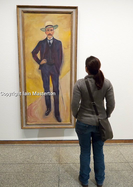 woman looking at painting Harry Graf Kessler by Edvard Munch  in Neue Nationalgalerie in Kulturforum in Berlin Germany