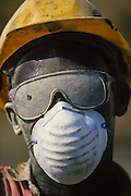 Industrial worker wearing safety goggles  covered with dust