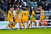 Goal.  Cambridge celebrate scoring their opening goal.  during the Sky Bet League 2 match between Plymouth Argyle and Cambridge United at Home Park, Plymouth, England on 12 December 2015. Photo by Graham Hunt.