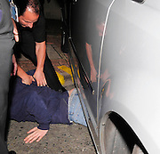 11.OCTOBER.2009 - LONDON<br /> <br /> ROBBIE WILLIAMS' DRIVER RAN OVER A PHOTOGRAPHER WHO GOT STUCK UNDER THE CAR WITH POLICE AND AN AMBULANCE TURNED UP ROBBIE RAN BACK INSIDE THE STUDIOS AND LEFT OUT ANOTHER EXIT 10 MINUTES LATER IN ANOTHER CAR.<br /> <br /> BYLINE: EDBIMAGEARCHIVE.COM<br /> <br /> *THIS IMAGE IS STRICTLY FOR UK NEWSPAPERS & MAGAZINES ONLY*<br /> *FOR WORLDWIDE SALES & WEB USE PLEASE CONTACT EDBIMAGEARCHIVE-0208 954 5968*