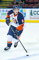 KELOWNA, CANADA - AUGUST 30: Kamloops Blazers prospect #5 Travis Verveda skates with the puck against the Kelowna Rockets  on August 30, 2014 during pre-season at Prospera Place in Kelowna, British Columbia, Canada.   (Photo by Marissa Baecker/Shoot the Breeze)  *** Local Caption *** Travis Verveda;