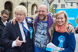 © Licensed to London News Pictures.  02/05/2015. ABINGDON, UK. Boris Johnson (left) talks to voters while campaigning in Abingdon with Nicola Blackwood (right in blue coat) who is standing for re-election as MP for the Oxford West and Abingdon constituency. Photo credit: Cliff Hide/LNP
