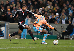 MARSEILLE, FRANCE - Tuesday, December 11, 2007: Liverpool's Ryan Babel and Olympique de Marseille's Jacques Faty during the final UEFA Champions League Group A match at the Stade Velodrome. (Photo by David Rawcliffe/Propaganda)