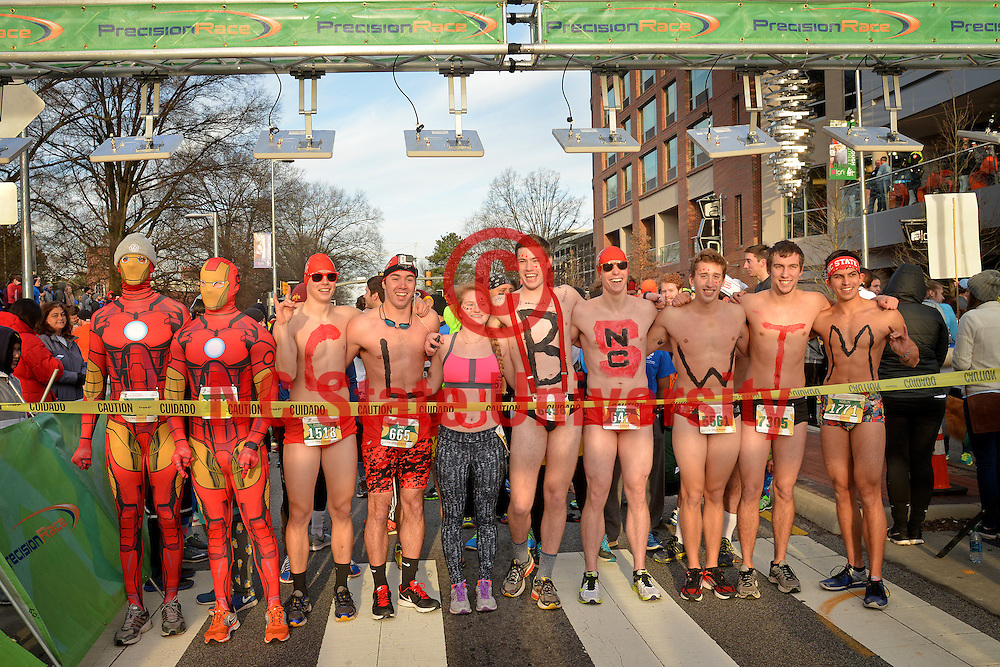 Two Iron Men and the half naked Club Swim take up the front line at Krispy Kreme Challenge.