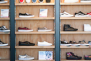 Interior of Vans store shoes on display on the wall