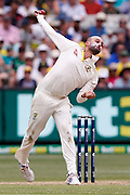 Nathan Lyon bowls a ball during day three of the Australia v England fourth test at the Melbourne Cricket Ground, Melbourne, Australia on 28 December 2017. Photo by Mark  Witte.