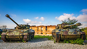 Army tanks and bombed building at the Karlovac war memorial, Karlovac, Croatia