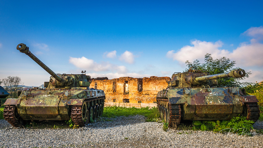Army tanks and bombed building at the Karlovac war memorial, Karlovac, Croatia