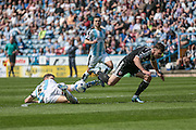 Mark Hudson (C) (Huddersfield Town) stops Sergi Canos (Brentford) getting through towards the goal during the Sky Bet Championship match between Huddersfield Town and Brentford at the John Smiths Stadium, Huddersfield, England on 7 May 2016. Photo by Mark P Doherty.