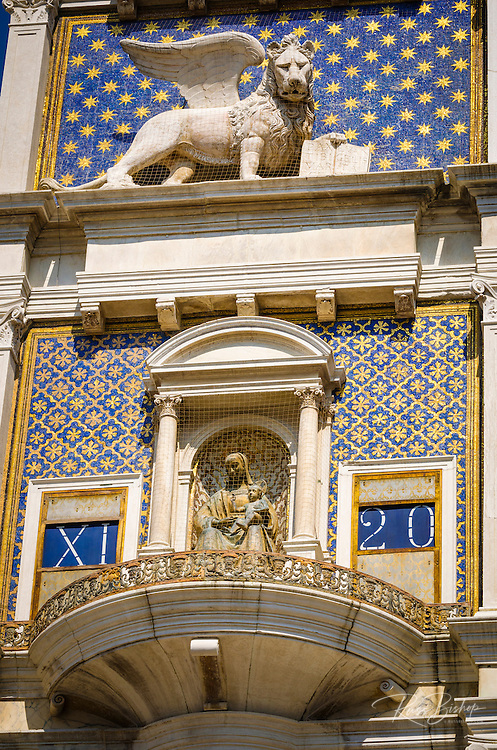 The Torre dell'Orologio (Clock tower) and winged lion statue, Piazza San Marco, Venice, Veneto, Italy
