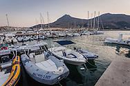 Photo of boats docked at the marina in Favignana, a small island off the coast of Sicily, Italy