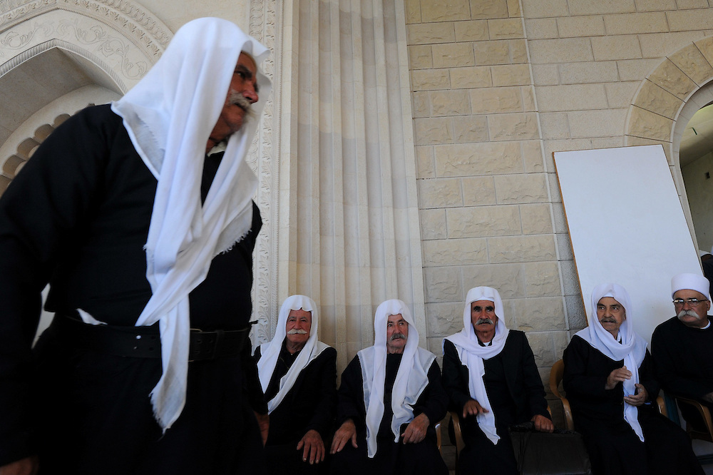 "Elder ISraeli Druze men attend the celebrations of Nabi Shuayb Druze holiday at the tomb of Nabi Shuayb (meaning ""the Prophet Jethro""), the site in the destroyed village of Hittin not far from Tiberias, where the tomb of the Islamic prophet Shu'ayb (Biblical Jethro) is believed to be located. During the festivities, mass celebrations are held at Nabi Shu'ayb, and Druze religious leaders gather there for ritual purposes and to discuss religious questions. Photo by Gili Yaari"