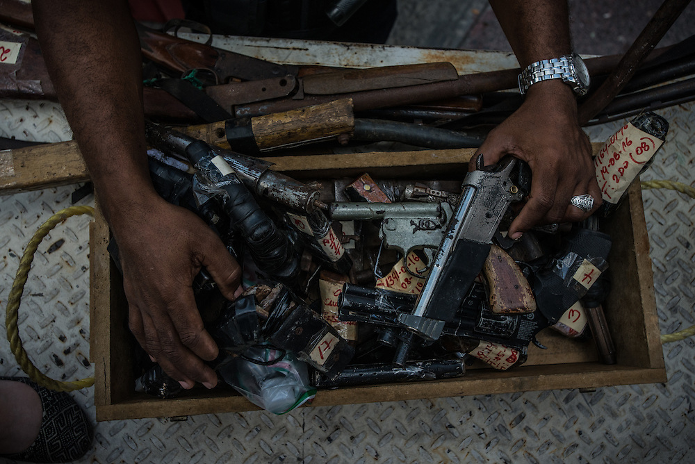 CARACAS, VENEZUELA - OCTOBER 31, 2016: National Guard soliders destroy hundreds of guns used in crimes and confiscated by police. Although widely seen by the public as as a show of force, critics point out that most arms in the country are illegally sold to criminal networks by the military. PHOTO: Meridith Kohut for The New York Times