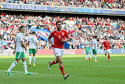 PARIS, FRANCE - Saturday, June 25, 2016: Wales' Hal Robson-Kanu celebrates Northern Ireland's own goal which sealed a 1-0 victory during the Round of 16 UEFA Euro 2016 Championship match at the Parc des Princes. (Pic by David Rawcliffe/Propaganda)
