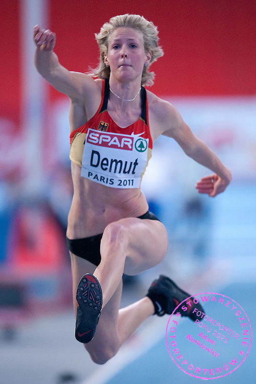 KATJA DEMUT (GERMANY) COMPETES IN WOMEN'S TRIPLE JUMP QUALIFICATION DURING EUROPEAN ATHLETICS INDOOR CHAMPIONSHIPS PARIS 2011 AT BERCY HALL...PARIS , FRANCE , MARCH 04, 2011..( PHOTO BY ADAM NURKIEWICZ / MEDIASPORT )..PICTURE ALSO AVAIBLE IN RAW OR TIFF FORMAT ON SPECIAL REQUEST.