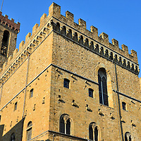 Bargello Palace in Florence, Italy<br /> In 1255, Florence's oldest public building, Bargello Palace, was the headquarters for the Captain of the People and, in the 16th century, the Captain of Police.  This stark, fortified building served as a prison until, in 1865, it became the Museo Nazionale del Bargello. Inside is a wonderful collection of famous Italian statues, including several by Michelangelo.