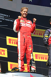 26.07.2015, Hungaroring, Budapest, HUN, FIA, Formel 1, Grand Prix von Ungarn, das Rennen, im Bild Sebastian Vettel (Scuderia Ferrari) ballt die Faeuste // during the race of the Hungarian Formula One Grand Prix at the Hungaroring in Budapest, Hungary on 2015/07/26. EXPA Pictures © 2015, PhotoCredit: EXPA/ Eibner-Pressefoto/ Bermel<br /> <br /> *****ATTENTION - OUT of GER*****