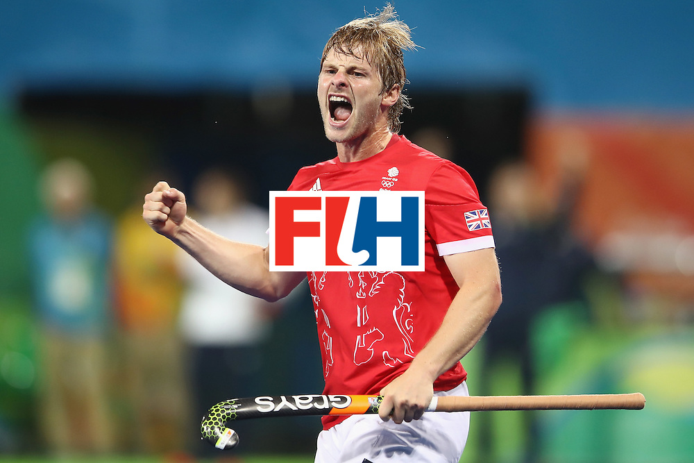 RIO DE JANEIRO, BRAZIL - AUGUST 10:  Ashley Jackson of Great Britain celebrates scoring a goal during the men's pool A match between Great Britain and Australia on Day 5 of the Rio 2016 Olympic Games at the Olympic Hockey Centre on August 10, 2016 in Rio de Janeiro, Brazil.  (Photo by Mark Kolbe/Getty Images)