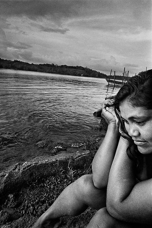 Brazil, Oiapoque, Amapa.<br /> <br /> Oiapoque, est le dernier point de passage bresilien d&rsquo;une prostitution plus ou moins organisee vers la Guyane fran&ccedil;aise.<br /> Pendant que les hommes partent faire les garimpeiros en foret, les jeunes femmes viennent tenter leur chance &agrave; la frontiere guyanaise. Elles font le bonheur des garimpeiros venus vendre leur or en ville.