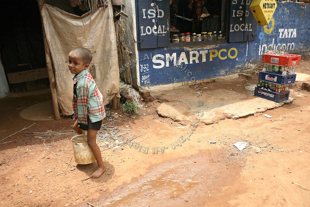 A child is carrying a bucket of water on the road of Salia Sahi slum (pop. 30.000) of Bhubaneswar, the capital of Orissa State, on Friday, May 16, 2008. **Italy and China Out**