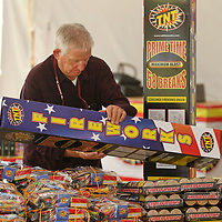 James Sanders, Pastor at Faimily Christian Center Church in Guntown, organizes the Fireworks on his sales tables Monday in Saltillo for their Fouth of July customers. The sales from the Fireworks tents on Highway 145 in Saltillo near Insustrial Park Road and the Fred's location are fundraisers for Faimily Christian Center Church in Guntown.