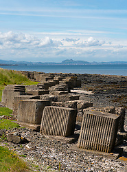Second World War era anti-tank blocks on shore at Gosford Sands at Longiddry in East Lothian, Scotland, UK