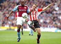 2003-05-03<br />Barclaycard Premiership<br />Aston Villa v Sunderland<br /><br />ASTON VILLA'S DARIUS VASSELL AND SUNDERLAND'S GAVIN MCCANN DURING TODAYS PREMIERSHIP GAME.<br /><br />PIC BY DANIEL HAMBURY/SPORTSBEAT IMAGES