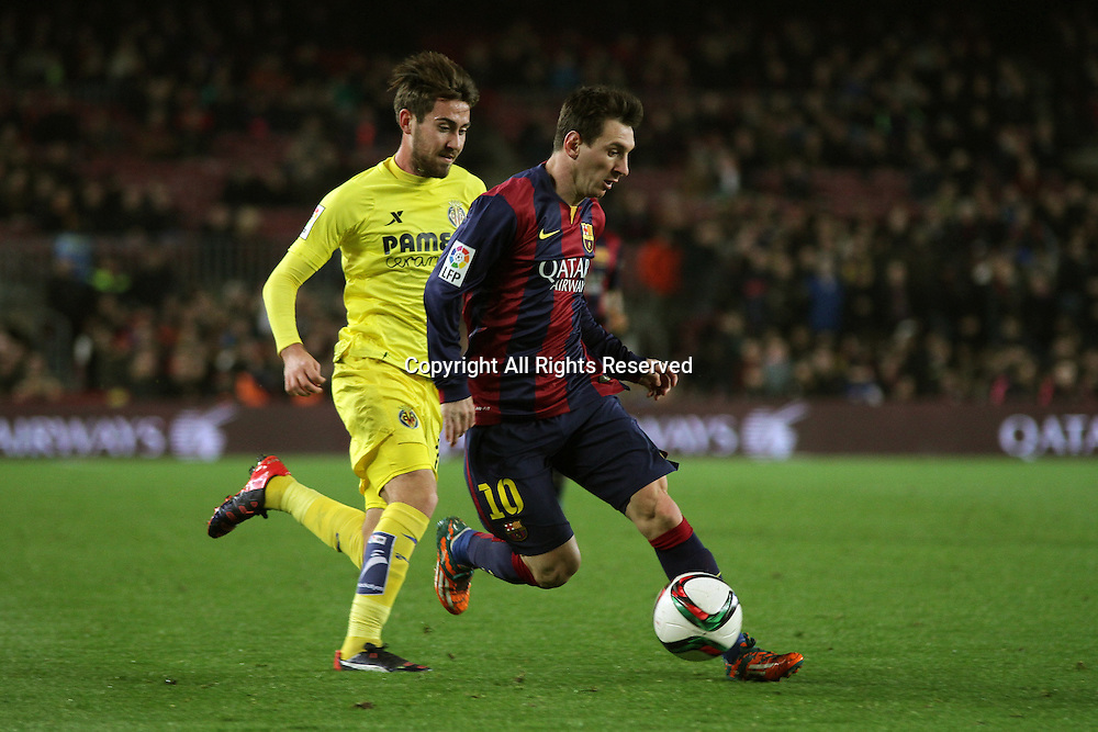11.02.2015.  Barcelona, Spain. Copa del Rey Semi final 1st Leg. Barcelona versus Villarreal.<br /> Messi beats Victor Ruiz around the outside