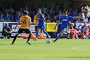 AFC Wimbledon midfielder Anthony Hartigan (8) passing the ball during the EFL Sky Bet League 1 match between AFC Wimbledon and Bristol Rovers at the Cherry Red Records Stadium, Kingston, England on 21 September 2019.