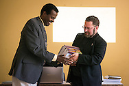 The Rev. Dr. Albert B. Collver, LCMS director of Church Relations and Regional Operations, gives books to Mekane Yesus Seminary President Rev. Dr. Belay Gula during introductions at the seminary on Monday, Nov. 10, 2014 in Addis Ababa, Ethiopia. LCMS Communications/Erik M. Lunsford