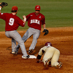 June 05, 2011; Tallahassee, FL, USA; Alabama Crimson Tide short stop Jared Reaves (9) gets a force out against Florida State Seminoles left fielder Stuart Tapley (27) during the second inning of the Tallahassee regional of the 2011 NCAA baseball tournament at Dick Howser Stadium. Mandatory Credit: Derick E. Hingle