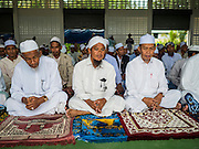 16 JUNE 2015 - CHANAE, NARATHIWAT, THAILAND: Muslim men wait at a prayer service in Chanae. About 600 people from Muslim communities in Chanae district of Narathiwat province came to the district offices Tuesday morning to participate in a prayer for peace during Ramadan. About 6,000 people have been killed in sectarian violence in Thailand's three southern provinces of Narathiwat, Pattani and Yala since a Muslim insurgency started in 2004. Attacks usually spike during religious holidays. Insurgents are fighting for more autonomy from the central government in Bangkok.        PHOTO BY JACK KURTZ