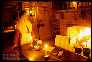 Woman in period dress @ Dr Allen's Cabin prepares to roll pills for Candlelight Tour; New Salem. Illinois