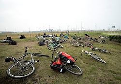 "© Licensed to London News Pictures. 30/08/2015. Calais, France. Around a hundred British cyclists from ""Critical mass to Calais"" gather at their arrival to Calais from London as they are to donate bicycles to the people in the refugee camp, also known as the Jungle, as well as supplies to support the life at the site. Photo credit : Isabel Infantes/LNP"