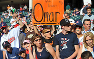Fans at Progressive Field in  Cleveland wait for Omar Vizquel to appear from the Giants dugout.
