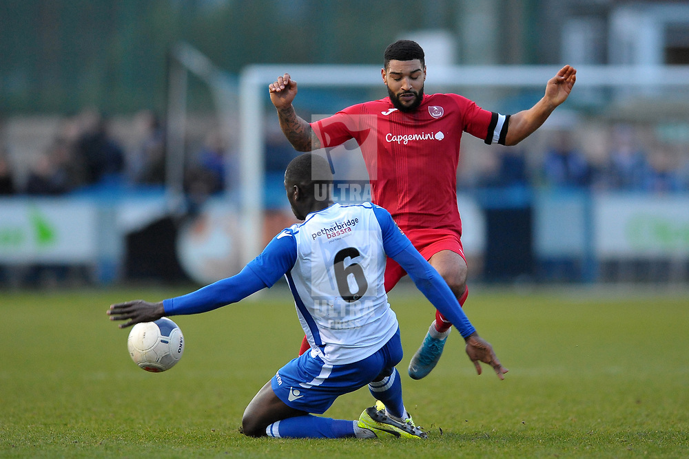 TELFORD COPYRIGHT MIKE SHERIDAN Ellis Deeney of Telford taes on Kennedy Digie  during the Vanarama Conference North fixture between Guiseley and AFC Telford United at Nethermoor Park on Saturday, February 8, 2020.<br /> <br /> Picture credit: Mike Sheridan/Ultrapress<br /> <br /> MS201920-046