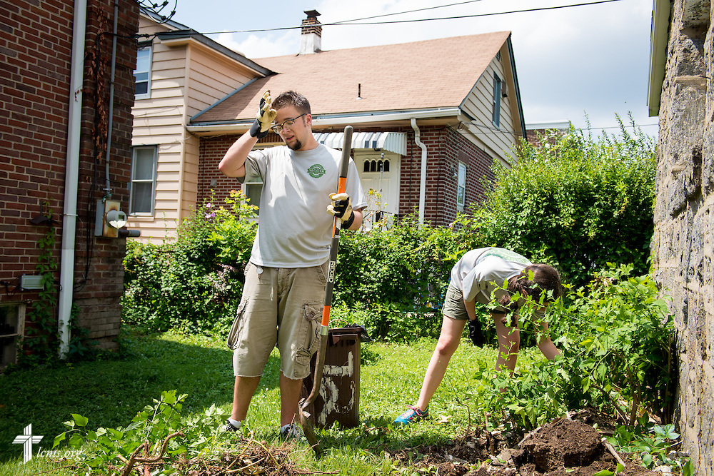 Matthew Rhodes wipes his brow after removing weeds during a service project in the 2014 Youth Corps pilot project at Shepherd of the City Lutheran Church on Wednesday, August 13, 2014, in Philadelphia, Pa. LCMS Communications/Erik M. Lunsford